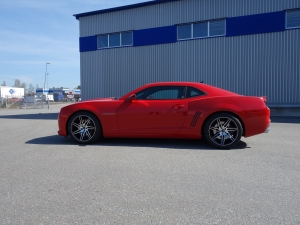 lackförsegling som lackskydd för bil på en röd bile